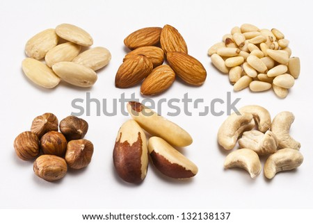 Almonds, bleached almonds, hazelnuts, brazil nuts, cashew nuts, pine nuts - stock photo