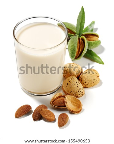 almonds drink with almonds isolated - stock photo