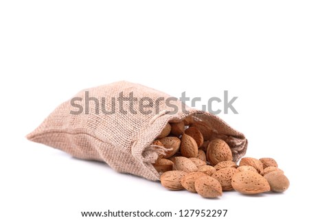 almonds in a bag on a white background - stock photo