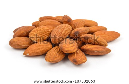 almonds in heap over white background - stock photo