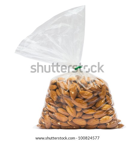 Almonds in plastic bag isolated on white with clipping path - stock photo