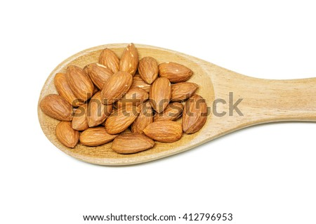 almonds in the wood spoon on white background. - stock photo
