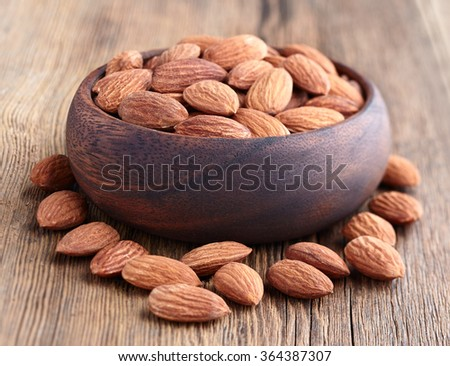 Almonds kernel on a wooden background - stock photo