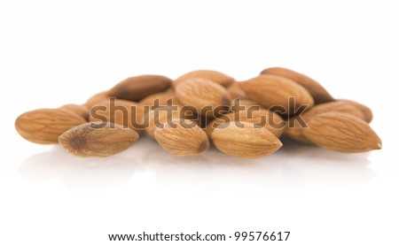 Almonds nuts, isolated on white. - stock photo
