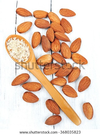 Almonds nuts with grated almond on white background  - stock photo