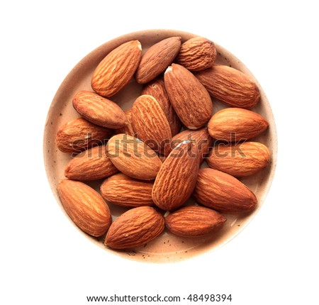 Almonds on a small dish. Isolated on a white background. - stock photo