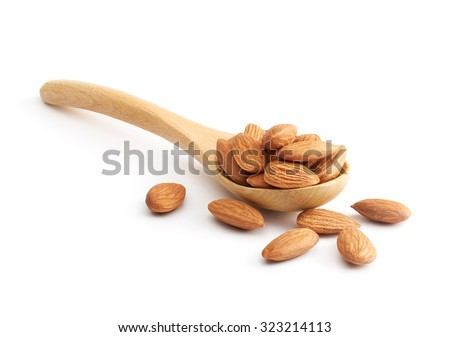 Almonds on wooden spoon isolated over white background - stock photo
