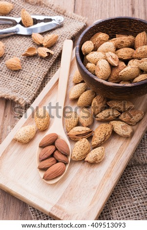 almonds set on the wooden plate, morning light,top view - stock photo