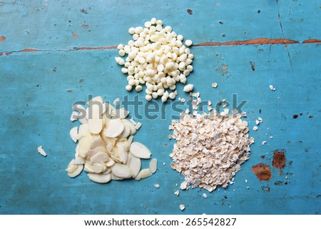 almonds, white chocolate chips, oat - stock photo