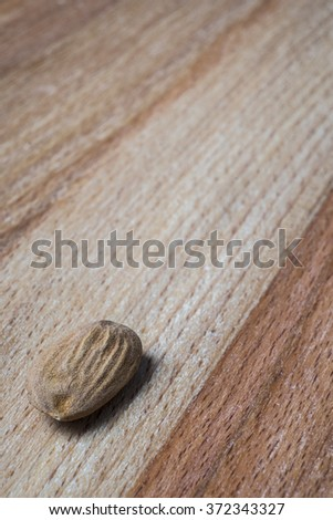 Almonds with wooden background - stock photo