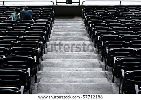 Almost empty tribune in baseball stadium - stock photo