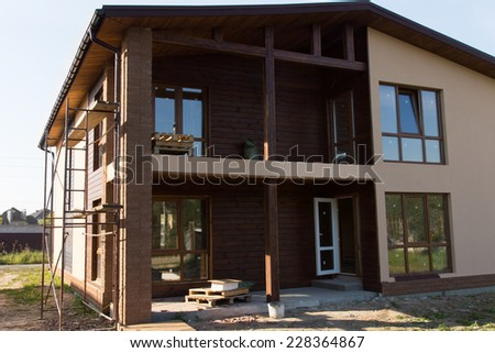 Almost Finish Real Estate Elegant Architectural Brown House Building with Glass Windows Style. - stock photo