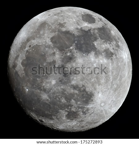 Almost full Moon taken with a powerful telescope with visible color variations on the surface. - stock photo