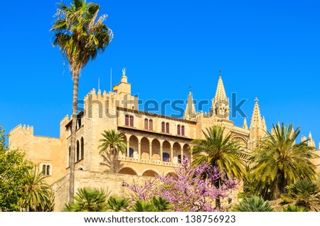 Almudaina Palace palm tree blooming spring time blue sky, Palma de Mallorca, Spain - stock photo
