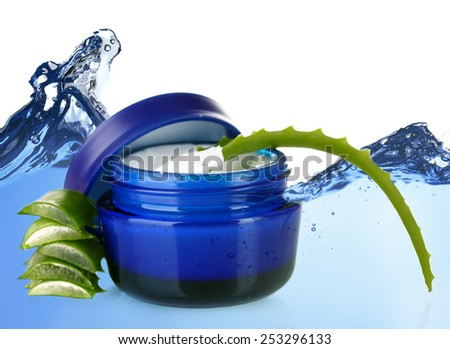Aloe Vera and cream on abstract blue water wave background - stock photo