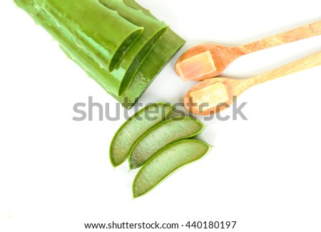 aloe vera fresh leaf and .wooden spoon isolated over white. - stock photo