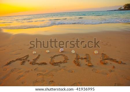 aloha written in the sand on the hawaiian beach - stock photo