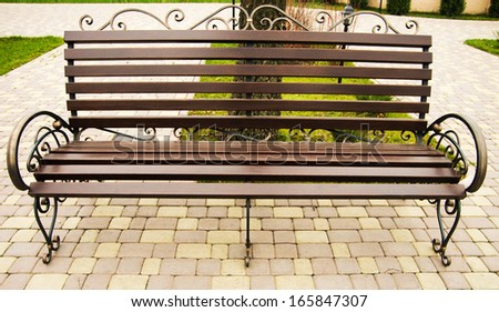 alone bench on the park - stock photo