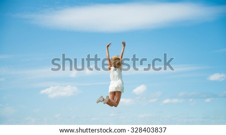 Alone blond young adult Woman Jumping for Joy on heaven above horizon One happy slim girl fly against blue summer sky with clouds Idea of success, growth , light, diet, luck, freedom, health, freedom - stock photo