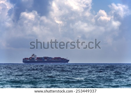 alone boat in tranquil sea - stock photo