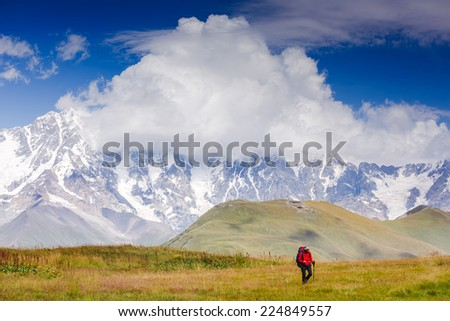 Alone hiker among the mountains. Sport lifestyle travel concept - stock photo