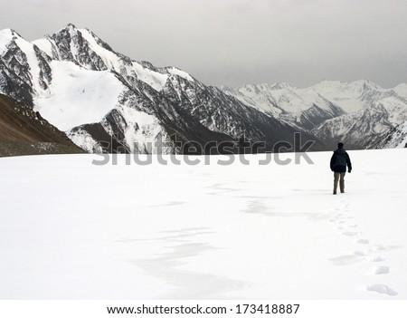 Alone man in the mountains - stock photo
