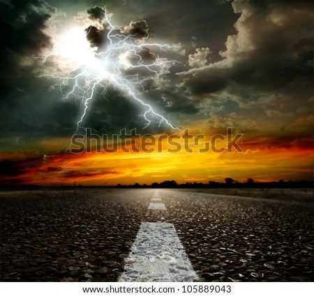 Along the road. Sunset and lightning - stock photo