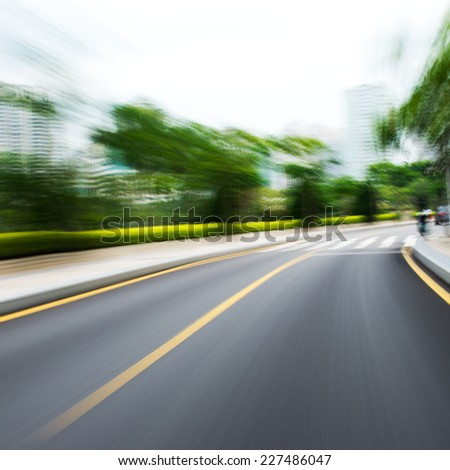 along the road with motion blur. - stock photo