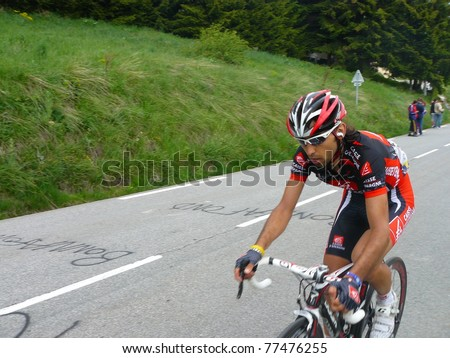 "ALPE D'HUEZ, FRANCE - JUN 12: Professional racing cyclist Matthieu Perget ride UCI WORLD TOUR "" CRITERIUM DU DAUPHINE LIBERE"" on June 12, 2010 in Alpe d'Huez pass, Isere, France. - stock photo"