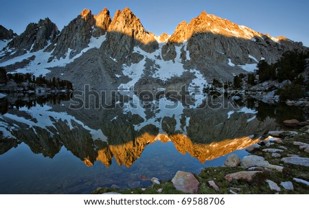 Alpen Glow at Sunset hits the Kearsarge Pinnacles in the Sierra Nevada - stock photo