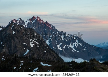 Alpenglow on Warrior Peak, Olympic National Park, WA - stock photo