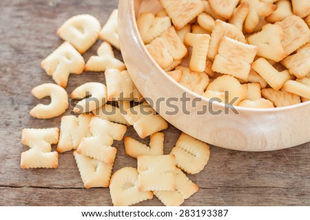 Alphabet biscuit in wooden tray, stock photo - stock photo