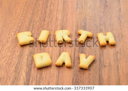 alphabet biscuit on wooden table, stock photo - stock photo