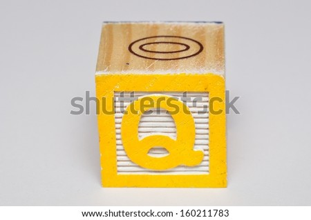 Alphabet block Q isolated on a white background - stock photo