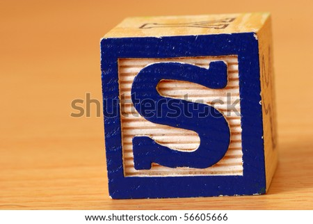 Alphabet block with a blue letter S - stock photo