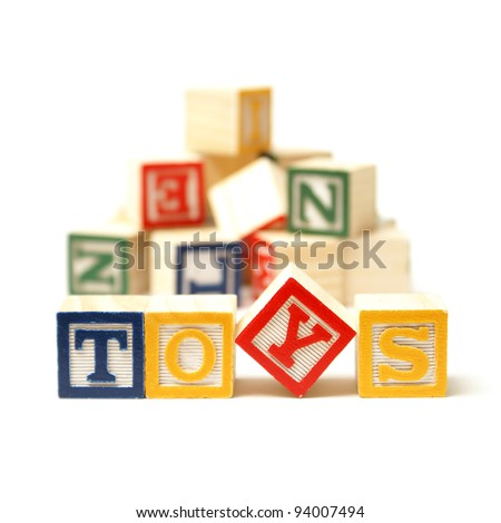 Alphabet blocks spell out the word toys with a touch of creativity. - stock photo