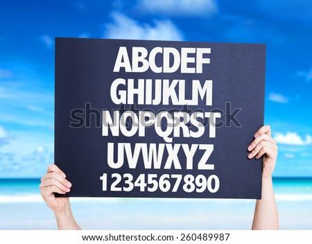 Alphabet card with beach background - stock photo