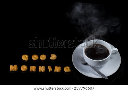 Alphabet cracker with cup of coffee with steam  - stock photo