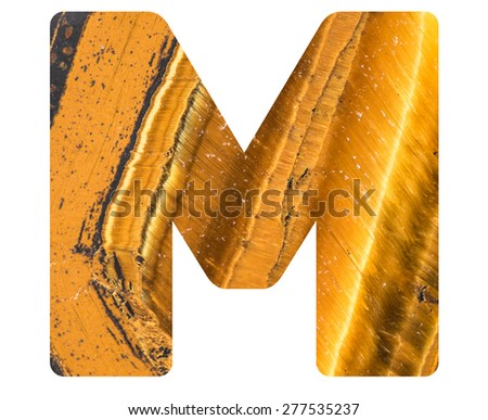 Alphabet from mineral tiger eye  isolated on white background -  letter M. - stock photo
