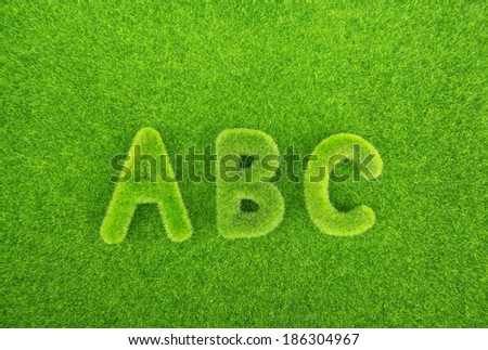 Alphabet letters ABC made from grass with grass background - stock photo