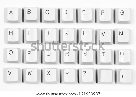 Alphabet made of letters from computer keyboard, white background - stock photo