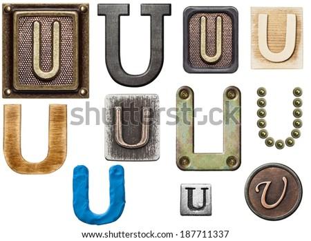 Alphabet made of wood, metal, plasticine. Letter U - stock photo
