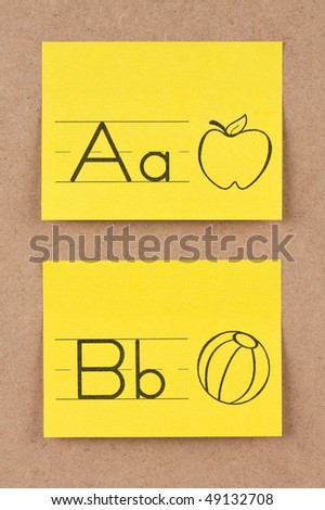 Alphabet notes on corkboard. Concept of learning. - stock photo