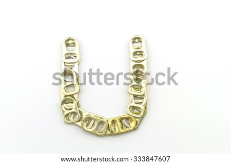 Alphabet  of U stack from  ring pull aluminum of cans on white background - stock photo