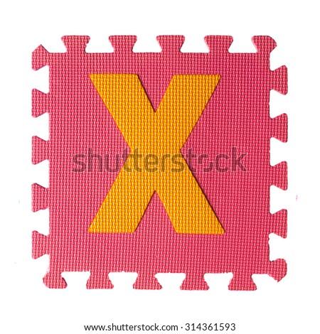 Alphabet puzzle pieces on white background - stock photo