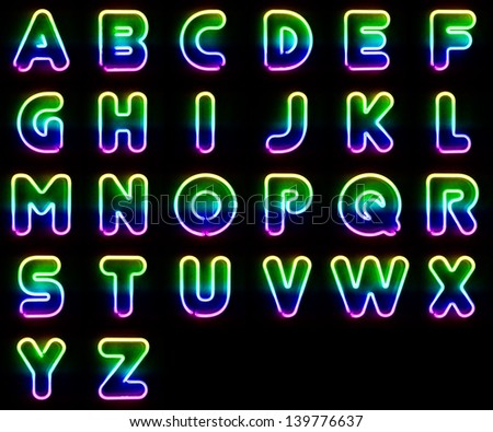 Alphabet set made out of colorful neon letters - stock photo