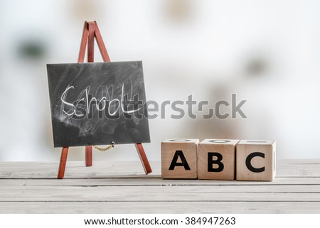 Alphabet teaching in the school with abc cubes - stock photo