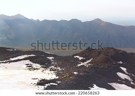 Alpine Campground. tents of climbers in the mountains. mountaineering. - stock photo