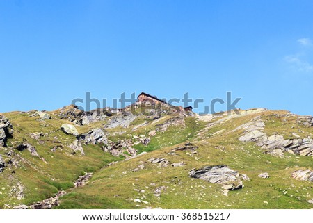Alpine hut Badener Hutte on mountain in Hohe Tauern Alps, Austria - stock photo