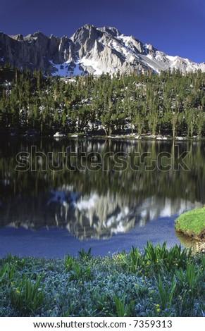 Alpine lake along Kearsarge Pass trail in Sierra Nevada mountains in eastern California - stock photo